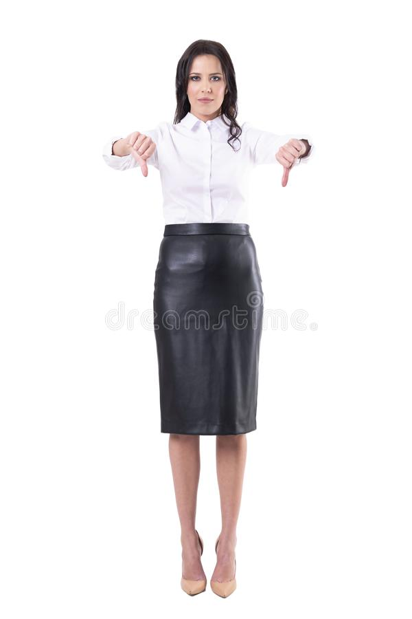 Beautiful disappointed business woman in formal clothes showing thumbs down disagree gesture. stock images