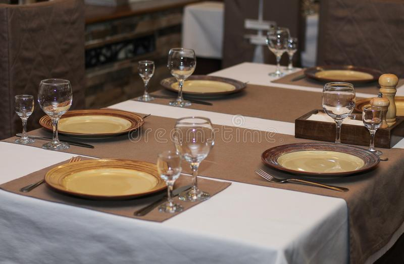 Beautiful dishes on the table in cafe or restaurant royalty free stock photos