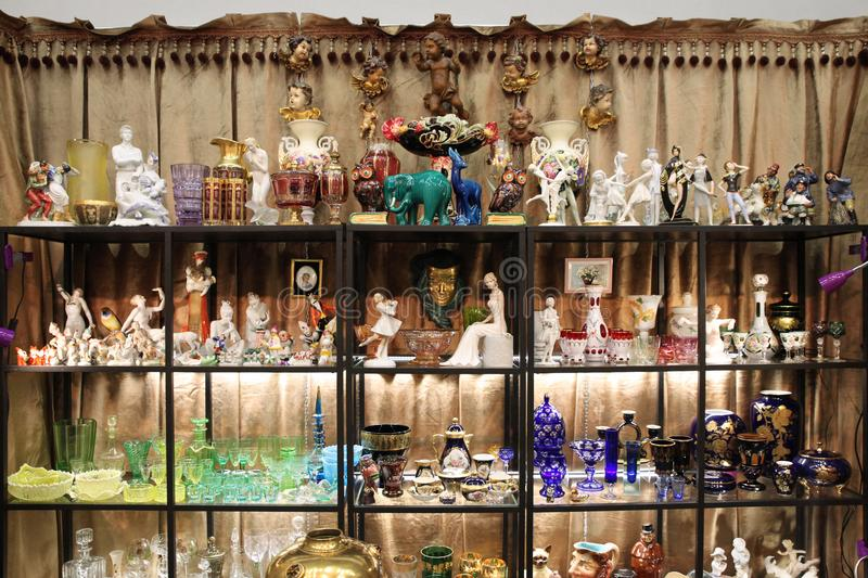Beautiful display of vintage figurines and kitchenware royalty free stock photo