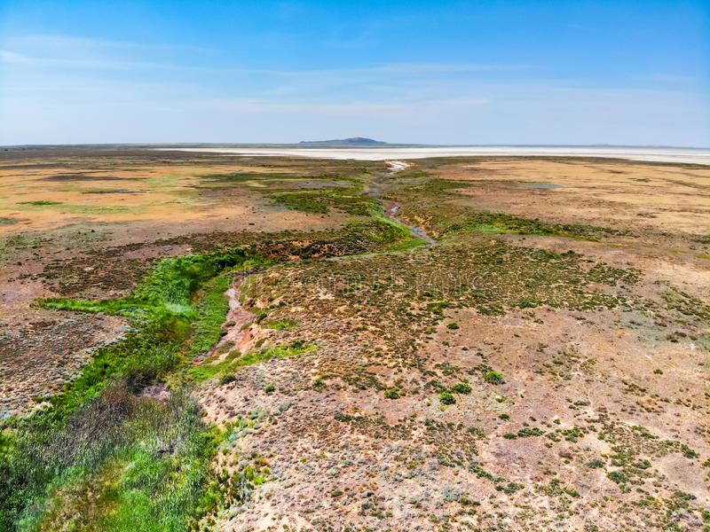Beautiful distant view of salt lake Baskunchak in Astrakhan region, Russia. Picturesque landscape with salt lake Baskunchak in Russia for natural background royalty free stock photography