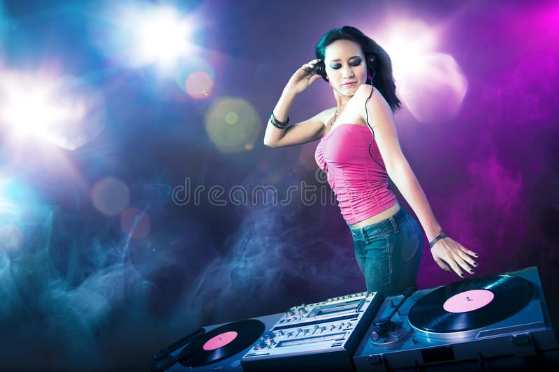 Beautiful DJ girl at the club