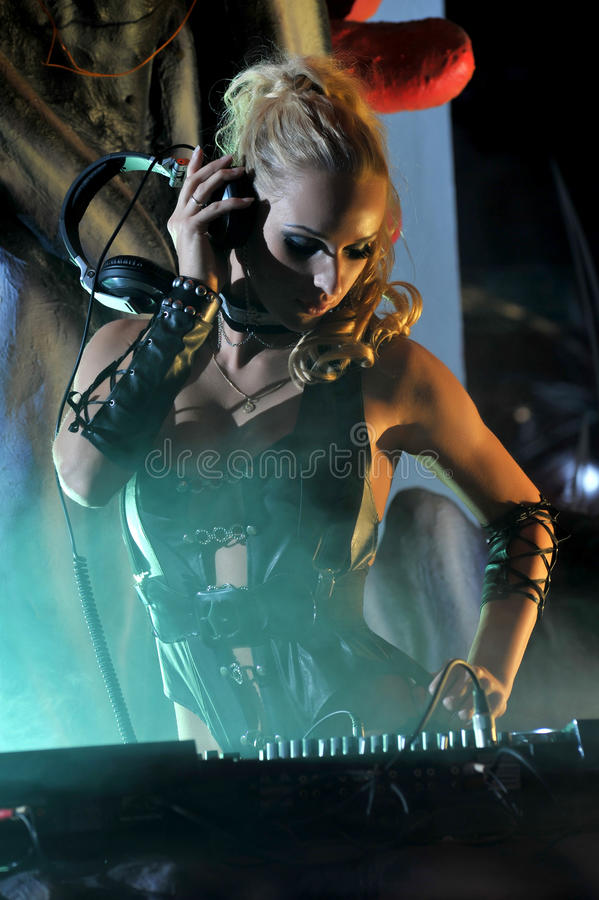 Beautiful DJ Girl On Decks Playing On The Party Stock Images