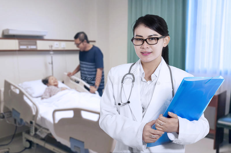Beautiful doctor looks confident in patient room royalty free stock photos