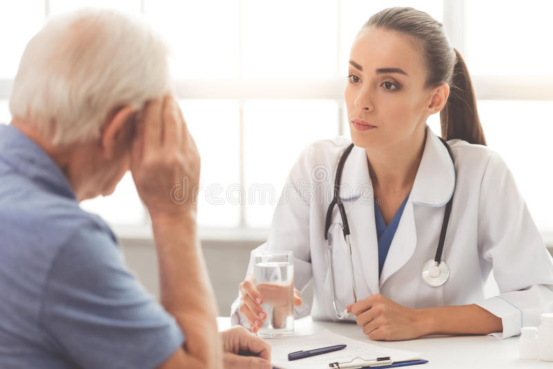Beautiful doctor and patient stock photos