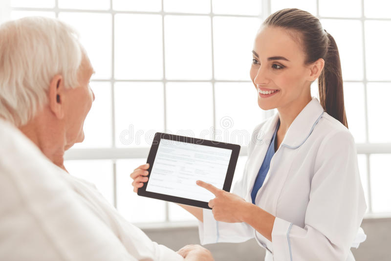 Beautiful doctor and patient stock photo
