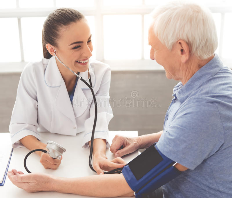 Beautiful doctor and patient royalty free stock photos