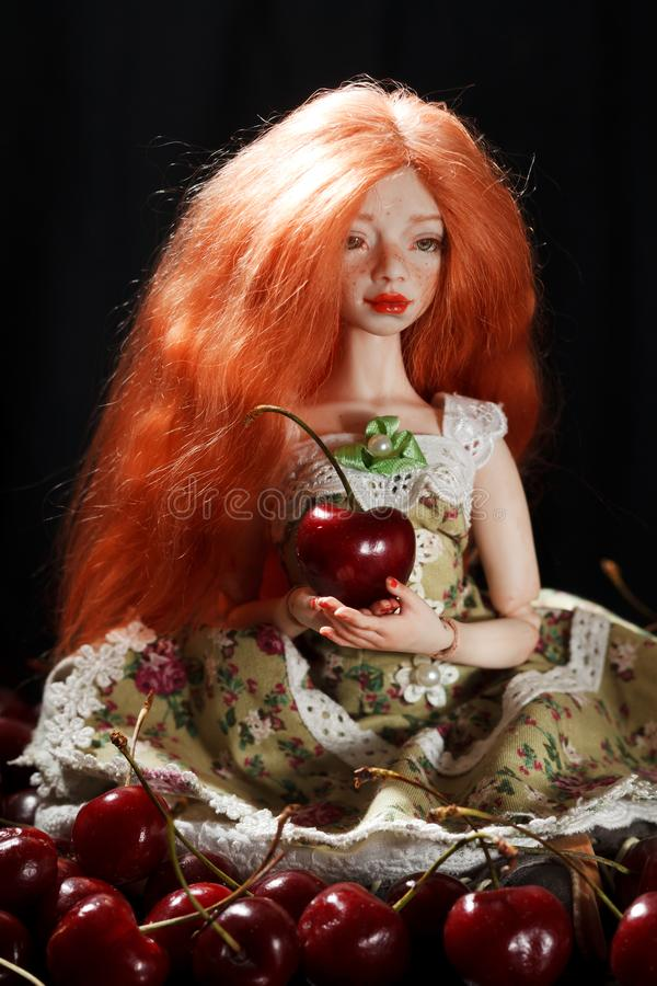 Doll and cherry stock image