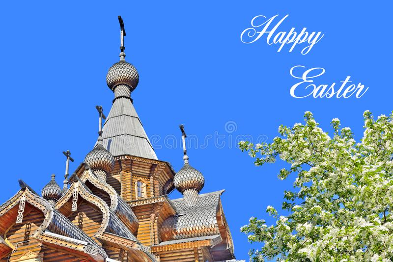 Domes and Crosses of wooden church and blossoming apple tree - Easter greeting card. Beautiful Domes and crosses of Christian wooden church and blossoming apple royalty free stock photos