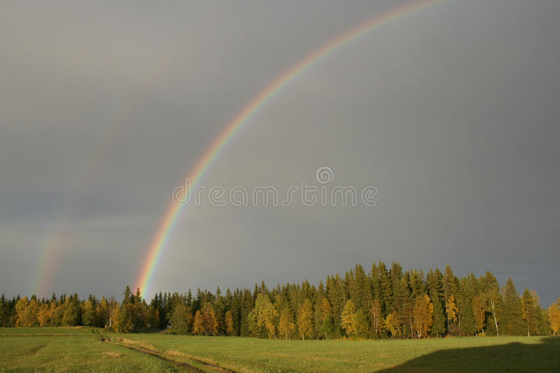 Download Beautiful double rainbow stock photo. Image of green - 14871910