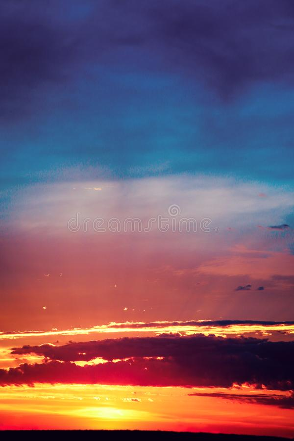 Beautiful dramatic orange sunset sky with vibrant lilac clouds landscape. Abstract wallpaper. Power of nature royalty free illustration