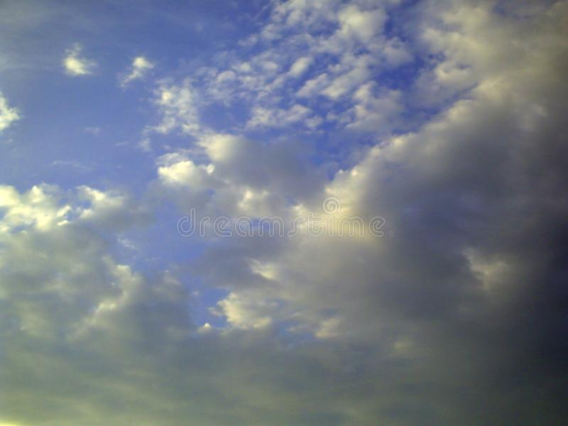 Beautiful dramatic sky with sun rays with clouds royalty free stock photography