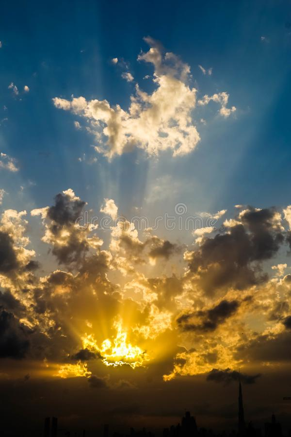 Dramatic Sunrise and Sunset in cloudy sky, Nature background with strong sunbeam, Hope concept. royalty free stock image