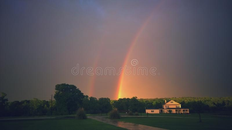 Beautiful dramatic twin rainbows during Texas thunder storms royalty free stock images