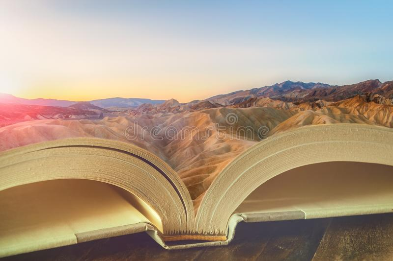 Beautiful dreamy landscape at sunrise on the pages of an open book. Reading, literacy, imaginary, education, story, travel. Beautiful dreamy landscape of stock photos