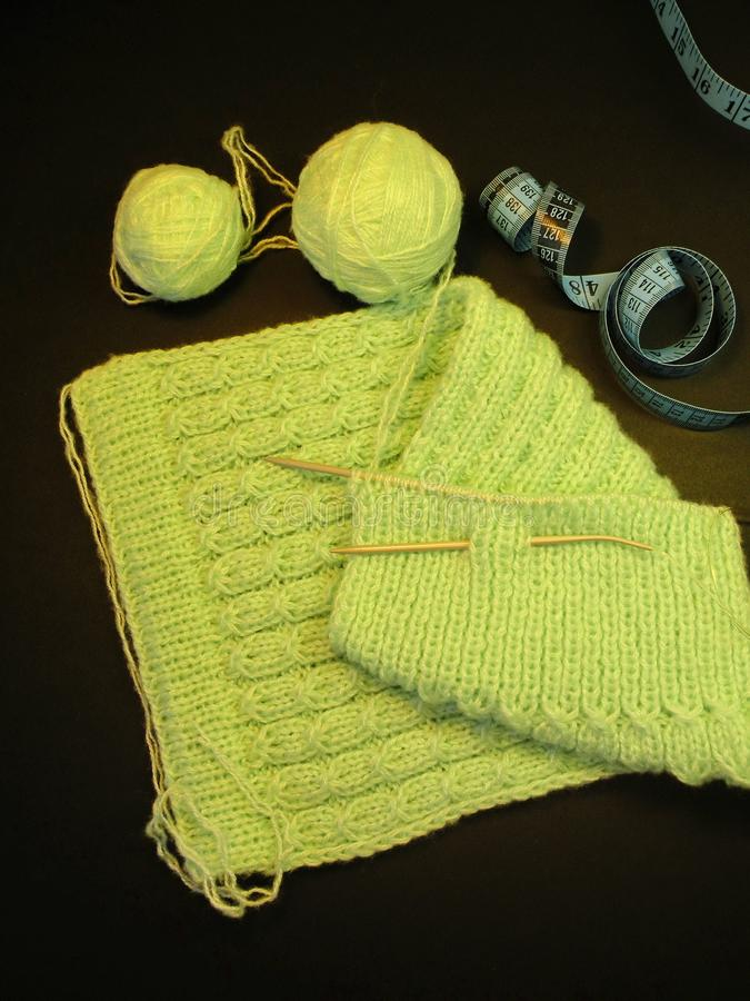 Green children dress knit and balls royalty free stock images