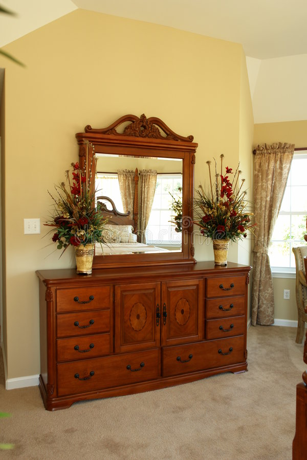 Beautiful dresser in bedroom royalty free stock photos