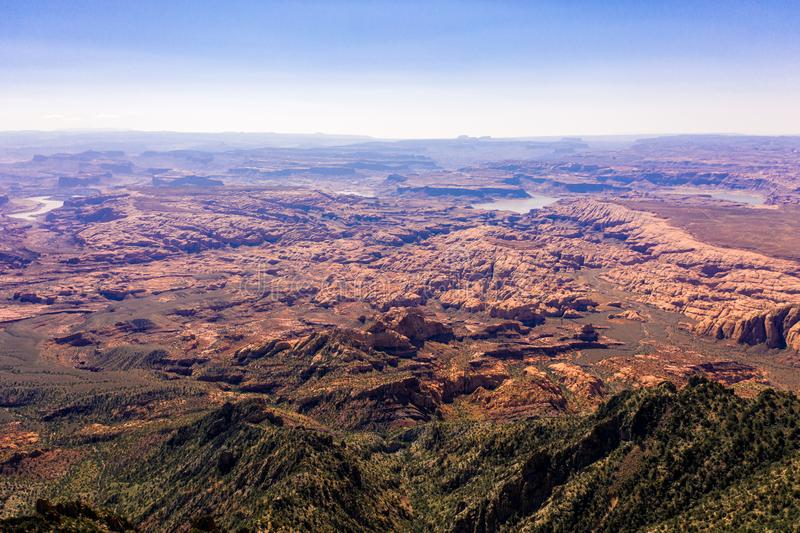 Aerial drone photo - Beautiful Henry Mountains in the Utah desert.  Lake Powell in the distance. A beautiful drone photo of the Henry Mountains and the rugged royalty free stock images