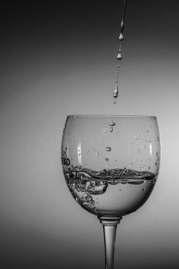 Beautiful drops of water in glass stock image
