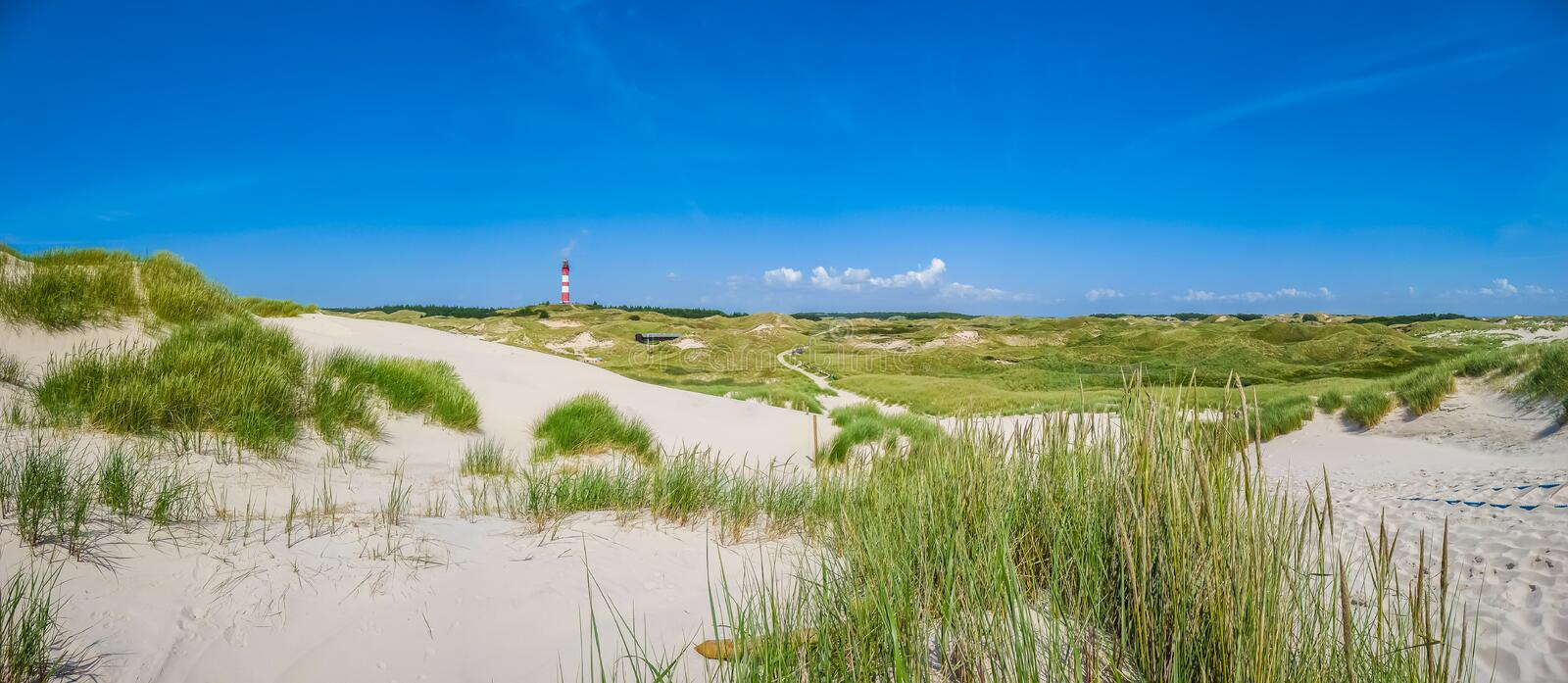 Beautiful dune landscape with traditional lighthouse at North Sea, Schleswig-Holstein, North Sea, Germany stock photos