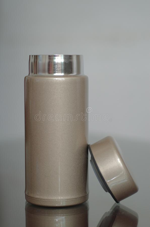 Durable thermos cup. It is a beautiful and durable vacuum cup on the glass,it is simple and durable stock image