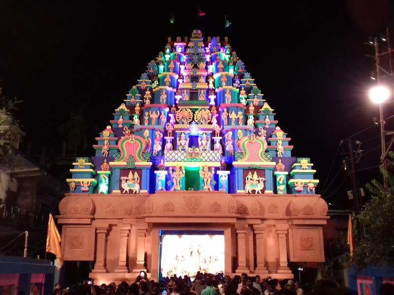 Beautiful durga puja pandal in dibrugarh assam. A very beautiful colourful durga puja pandal in turipati temple model is constructed at dibrugarh assam in india royalty free stock image