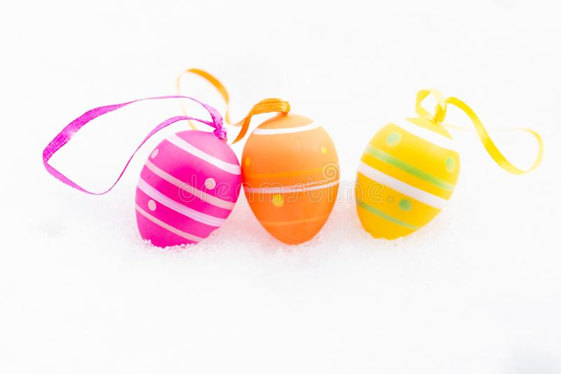Beautiful easter egg decoration on fresh white snow stock images