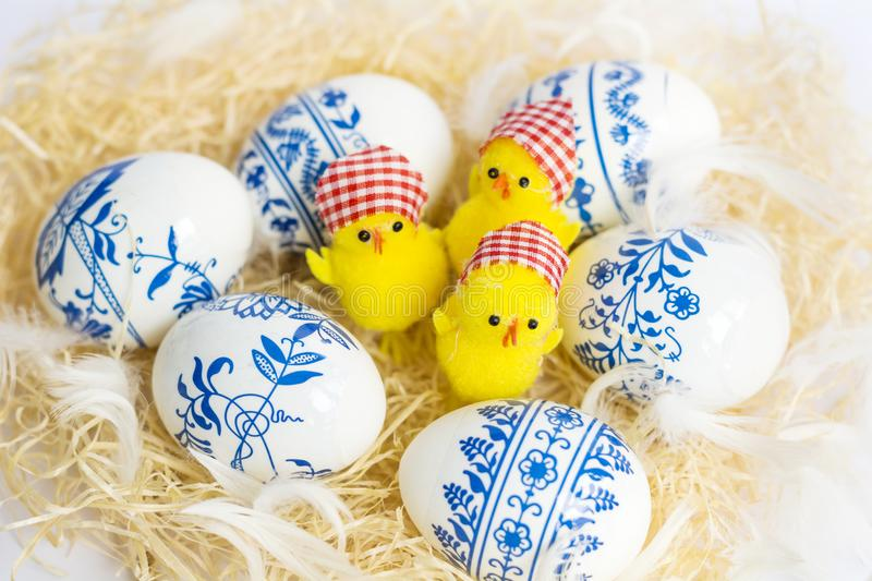 Beautiful Easter Eggs with Blue Painted Flowers and Chickens stock photo