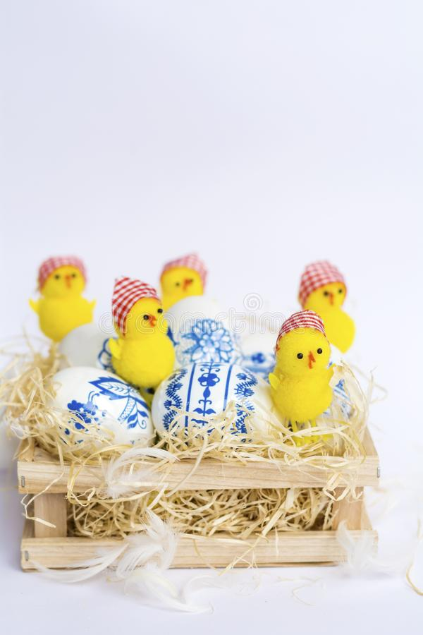Beautiful Easter Eggs with Blue Painted Flowers and Chickens royalty free stock photo