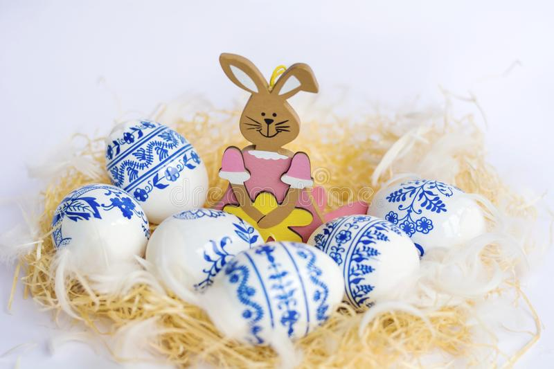 Beautiful Easter Eggs with Blue Painted Flowers and Easter Rabbit stock photography