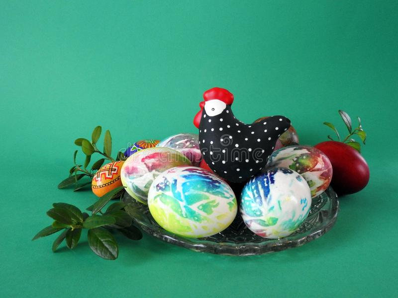 Colorful Easter eggs and hen in plate stock image