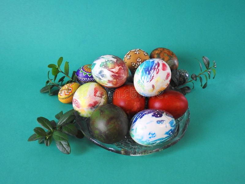 Colorful Easter eggs in plate royalty free stock photos
