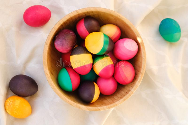 Decorative colorful Easter eggs in a wood bowl royalty free stock photo
