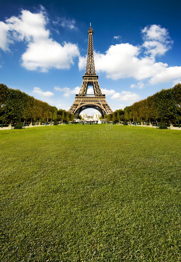 Beautiful Eiffel tower with huge grass copy space stock photography