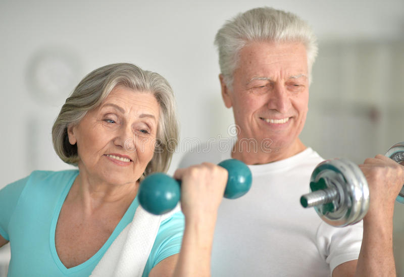Beautiful elderly couple in a gym stock photos