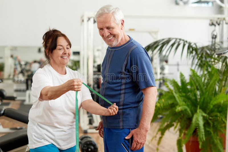 Beautiful elderly couple at sport club. stock images