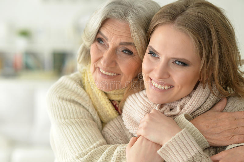 Beautiful elderly mother with an adult daughter stock photography