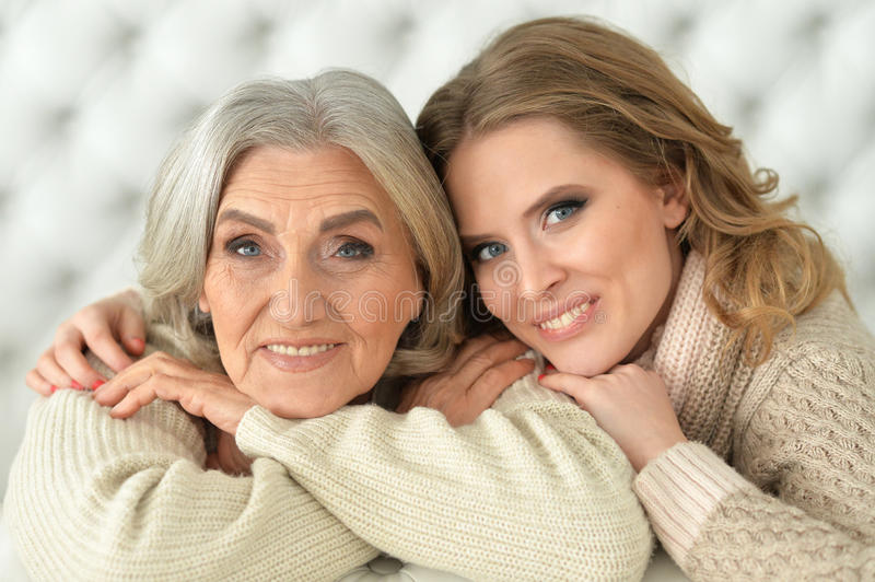 Beautiful elderly mother with an adult daughter royalty free stock image
