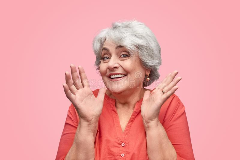 Beautiful elderly woman gesturing with hands royalty free stock photos