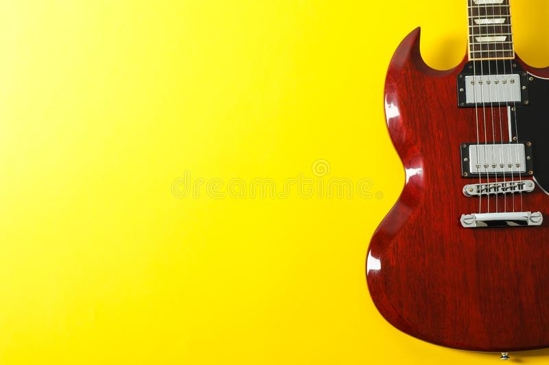 Beautiful electric guitar on yellow background royalty free stock images