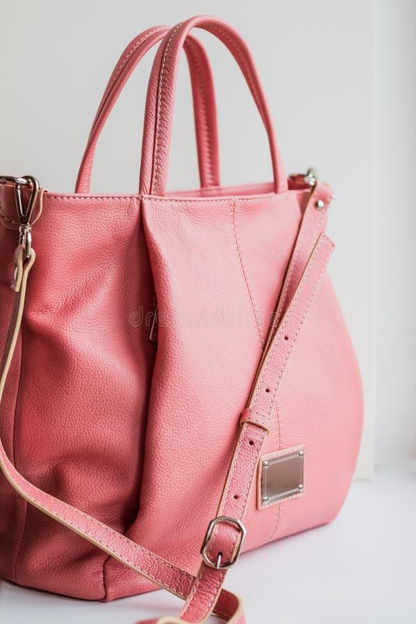 Beautiful elegance and luxury fashion leather pink women handbag isolated on white background stock images