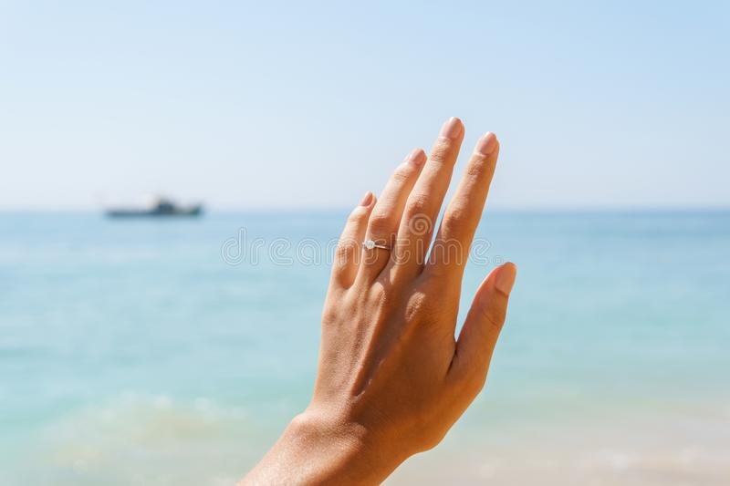 Beautiful Elegant Engagement Diamond Ring On Woman Finger stock images