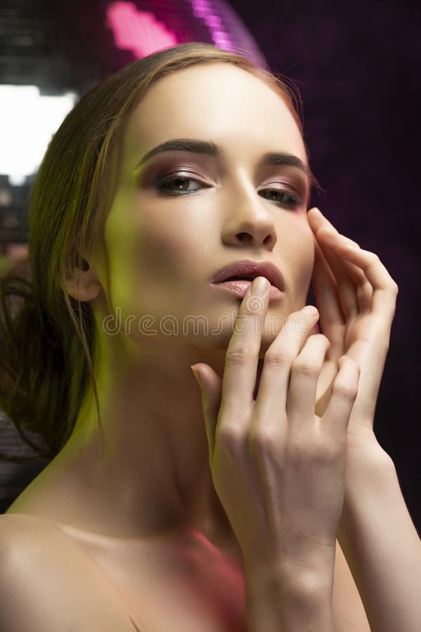 Beautiful elegant girl with a glamorous hairstyle and evening ma royalty free stock photos
