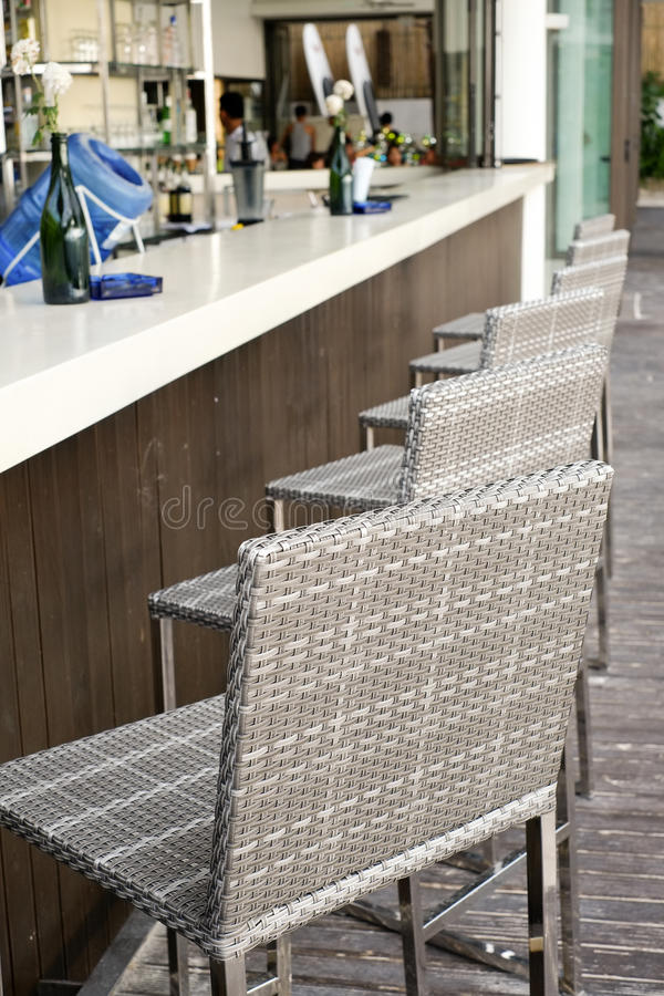 Beautiful elegant interior design, bar counter top with rattan chairs.  stock images