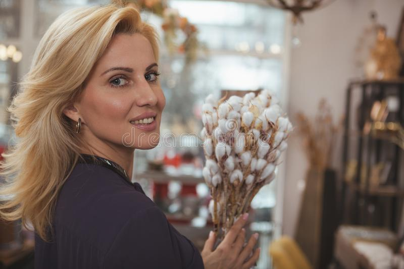 Gorgeous mature woman shopping at home decor store royalty free stock images