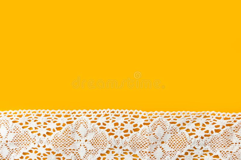 Beautiful elegant sewing crafts hobbies fashion clothing background with white cotton lace border on bright yellow backdrop stock photos