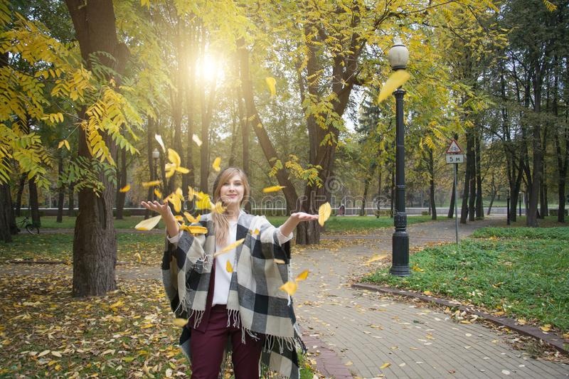 Beautiful elegant woman in autumn park royalty free stock images