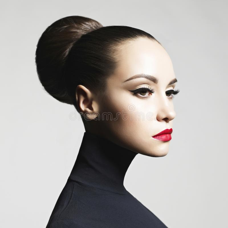 Beautiful elegant woman in black turtleneck stock photo