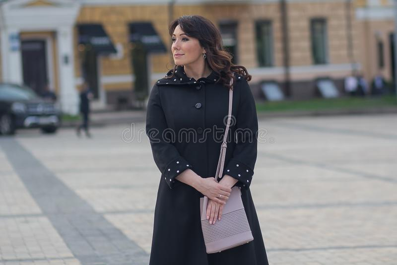 Beautiful elegant woman in the city royalty free stock photography