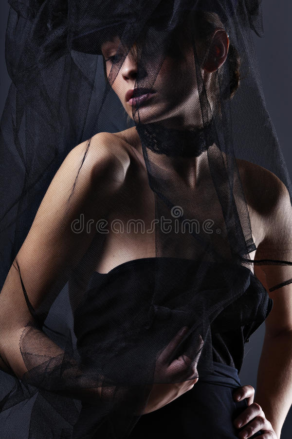 Beautiful elegant woman in a long dress royalty free stock images