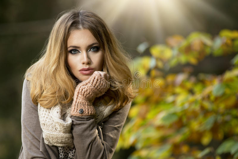 Beautiful elegant woman in park - autumn royalty free stock photo